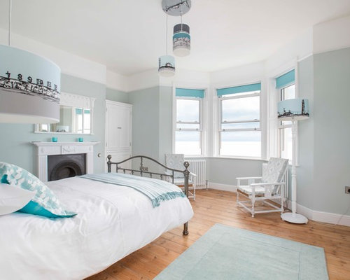Design Ideas For A Large Beach Style Master Bedroom In Kent With Blue  Walls, Light