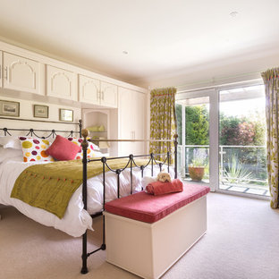 Design ideas for a traditional guest bedroom in Devon with beige walls, carpet and pink floor.