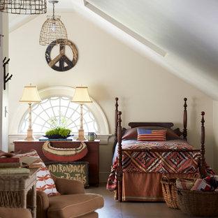 Country brown floor bedroom photo in New York with beige walls