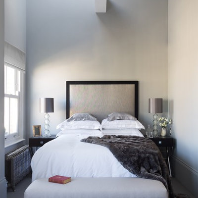 Inspiration for a mid-sized contemporary carpeted and gray floor bedroom remodel in London with gray walls