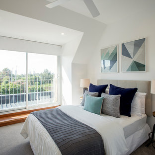Photo of a contemporary bedroom in Sydney with white walls, carpet and grey floor.