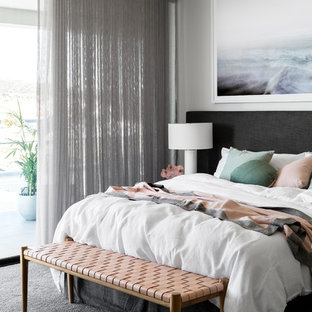 Inspiration for a contemporary master bedroom in Melbourne with white walls, carpet and grey floor.