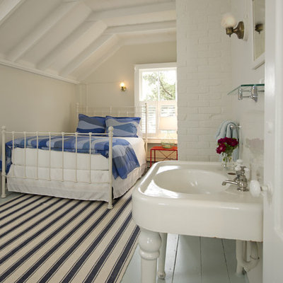 Inspiration for a mid-sized coastal guest painted wood floor and blue floor bedroom remodel in Boston with beige walls and no fireplace