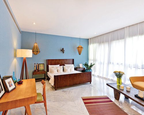 Example Of A Large Asian Marble Floor Bedroom Design In Mumbai With Blue  Walls