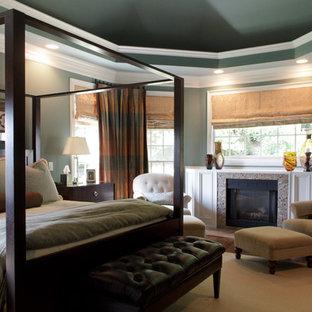 Идея дизайна: спальня в классическом стиле с фасадом камина из плитки и стандартным камином