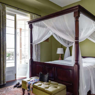 This is an example of a traditional master bedroom in Sydney with green walls.
