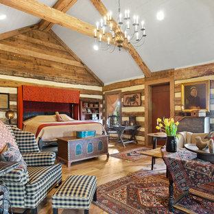 Mountain Style Master Medium Tone Wood Floor Bedroom Photo In Other