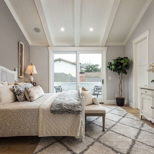 Bedroom - mid-sized country master light wood floor and brown floor bedroom idea in San Francisco with gray walls