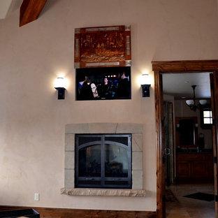 Foto de dormitorio principal, tradicional, de tamaño medio, con paredes beige, chimenea tradicional, marco de chimenea de piedra, suelo de madera oscura y suelo marrón