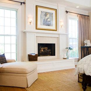 Idéer för ett mellanstort klassiskt huvudsovrum, med beige väggar, mellanmörkt trägolv, en standard öppen spis och en spiselkrans i sten