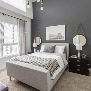 Example of a transitional carpeted bedroom design in Miami with gray walls