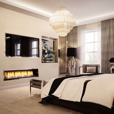 Example of a trendy master carpeted and beige floor bedroom design in West Midlands with beige walls and a ribbon fireplace