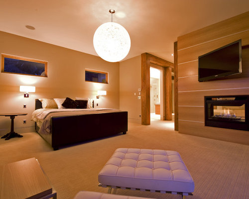 bedroom tv. Inspiration for a modern master bedroom remodel in Vancouver Lcd Bedroom Tv Wall Mount  Houzz