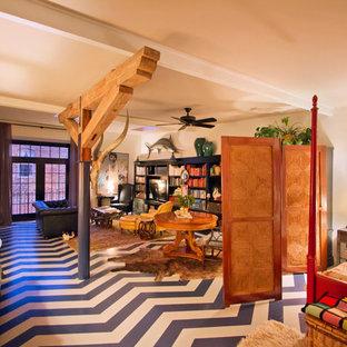 Imagen de dormitorio industrial con suelo multicolor