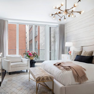 This is an example of a large transitional master bedroom in New York with beige walls, no fireplace, porcelain floors and beige floor.