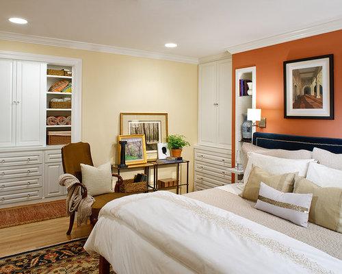 Trendy Master Medium Tone Wood Floor Bedroom Photo In DC Metro With Orange  Walls