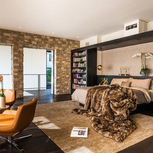 Bedroom - mid-sized contemporary master dark wood floor bedroom idea in Los Angeles with beige walls, a standard fireplace and a plaster fireplace