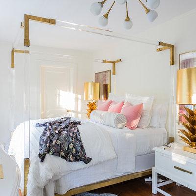 Bedroom - eclectic medium tone wood floor and brown floor bedroom idea in Raleigh with white walls