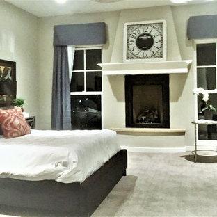 Imagen de dormitorio principal, tradicional renovado, extra grande, con paredes grises, moqueta, chimenea tradicional, marco de chimenea de madera y suelo gris