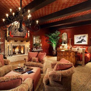 Foto di un'ampia camera matrimoniale chic con pareti rosse, parquet chiaro, camino classico, cornice del camino in pietra e pavimento marrone