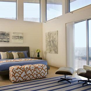 Example of a trendy medium tone wood floor bedroom design in Boston with beige walls