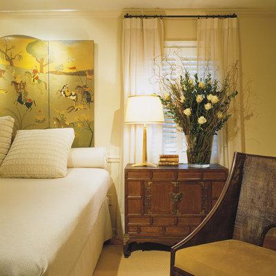 Example of a trendy bedroom design in DC Metro with beige walls