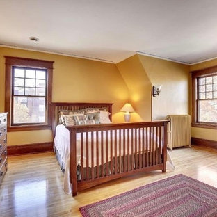 This is an example of a medium sized traditional master bedroom in Minneapolis with beige walls, limestone flooring, beige floors and no fireplace.