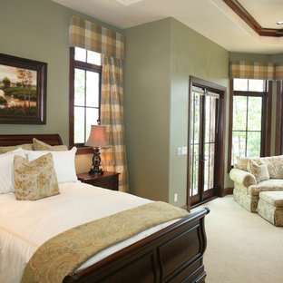 Example of a classic master beige floor bedroom design in Other with green walls