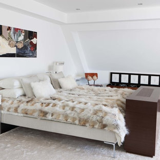 Design ideas for a medium sized modern master bedroom in London with white walls, dark hardwood flooring and brown floors.