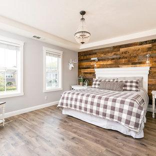 Bedroom - large farmhouse master laminate floor bedroom idea in Dallas with gray walls