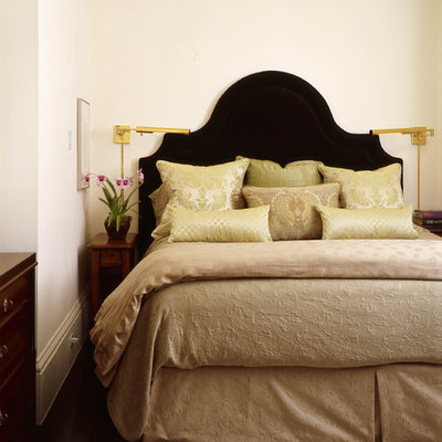 Inspiration for an eclectic bedroom remodel in Other with beige walls