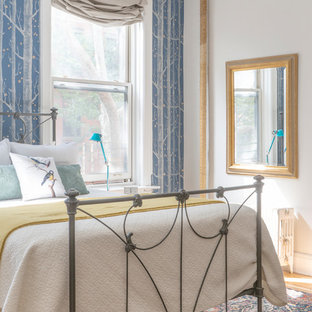 Inspiration for a medium sized contemporary master bedroom in New York with blue walls, light hardwood flooring, no fireplace and yellow floors.
