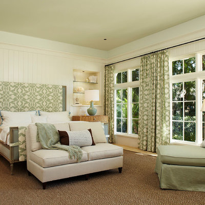 Example of a large classic master beige floor and light wood floor bedroom design in Miami with beige walls and no fireplace