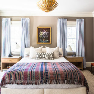 Inspiration for a large transitional master dark wood floor bedroom remodel in New Orleans with brown walls and no fireplace