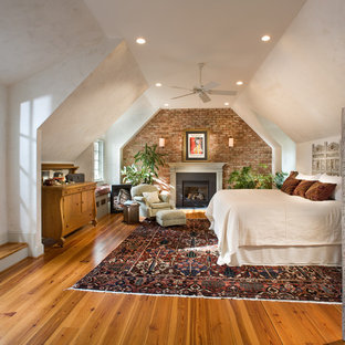 Eclectic master bedroom in DC Metro with a standard fireplace.