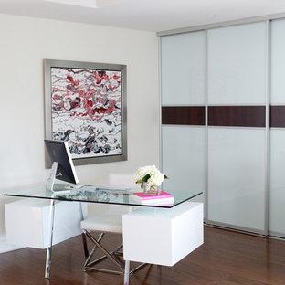 Bedroom - contemporary medium tone wood floor bedroom idea in Toronto with white walls