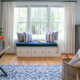 Inspiration for a transitional master light wood floor bedroom remodel in Portland Maine with gray walls