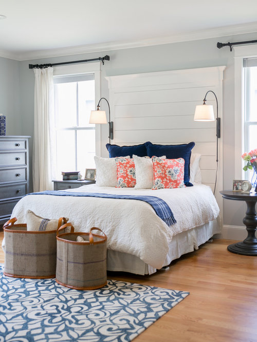 Bedroom mid sized beach style master light wood floor bedroom idea in portland maine