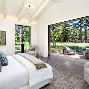 Photo of a mid-sized country master bedroom in San Francisco with white walls, medium hardwood floors and brown floor.