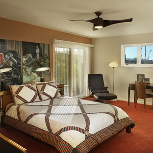 This is an example of an eclectic master bedroom in Phoenix with beige walls, carpet and red floor.