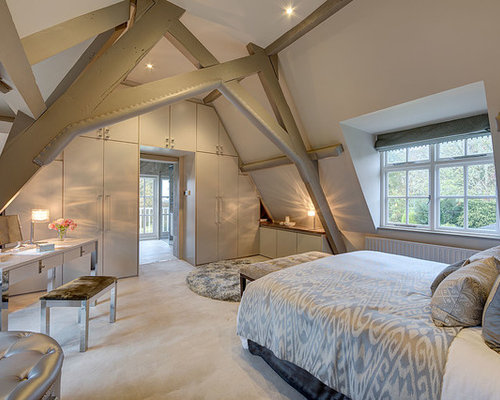 inspiration for a large farmhouse master bedroom remodel in surrey with white walls and carpet - Attic Bedroom Ideas