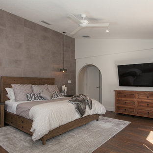 Large farmhouse master porcelain tile and brown floor bedroom photo in Miami with gray walls