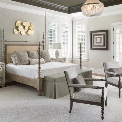 Example of a transitional bedroom design in St Louis