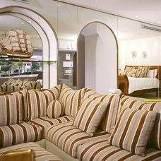 Mediterranean Bedroom by Jerry Jacobs Design, Inc.