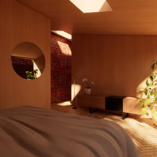 Ejemplo de dormitorio principal, moderno, pequeño, sin chimenea, con parades naranjas, suelo de ladrillo y suelo beige