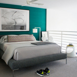 Design ideas for a mid-sized contemporary loft-style bedroom in Miami with green walls and no fireplace.