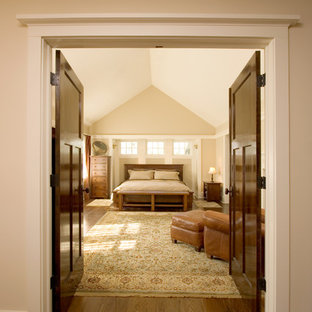 This is an example of a large arts and crafts master bedroom in New York with beige walls and medium hardwood floors.