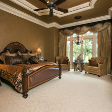 Mediterranean Bedroom by Terry M. Elston, Builder