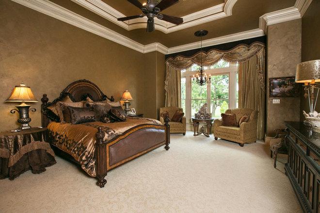 Mediterranean Bedroom by Terry M. Elston, Builder