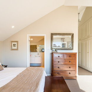 Photo of a mid-sized transitional master bedroom in Sydney with beige walls, carpet and beige floor.